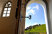 View out of the door of Zallinger church, Alpe di Siusi, South Tyrol, Italy, Europe