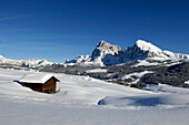 Wooden hut covered with snow, Plattkofel, Seiser Alm, Valle Isarco, South Tyrol, Trentino-Alto Adige, Italy