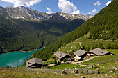 Farmhouses, mountain lake in the valley, Vernagt reservoir, Schnals Valley, Vinschgau, South Tyrol, Trentino-Alto Adige, Italy