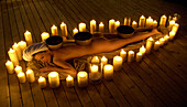 One woman lying in candle circle, Welness hotel, South Tyrol, Trentino-Alto Adige, Italy