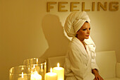 One woman sitting in bathrobe, Welness hotel, South Tyrol, Trentino-Alto Adige, Italy