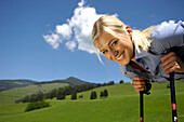 One young hikers looking at camera, Nordic Walking, South Tyrol, Trentino-Alto Adige, Italy