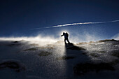Backlit person snowshoeing, Alto Adige, South Tyrol, Italy, Europe
