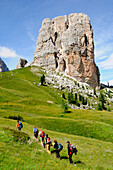 A group of hikers in a meadow in the mountains, Dolomiti ampezzane, Alto Adige, South Tyrol, Italy, Europe