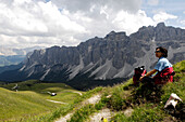 Hiking restin at Abteital valley, Nature reserve Geisler Puez, Dolomites, Alto Adige, South Tyrol, Italy, Europe