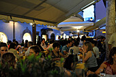 People in restaurants in the evening, Bolzano, South Tyrol, Alto Adige, Italy, Europe