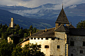 Medieval Proesels castle in front of overcast mountains, Voels am Schlern, South Tyrol, Alto Adige, Italy, Europe
