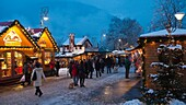 People at christmas market in the evening, Merano, Vinschgau, South Tyrol, Alto Adige, Italy, Europe