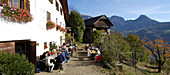 People in front of restaurant in the sunlight, Siffian, Ritten, South Tyrol, Alto Adige, Italy, Europe