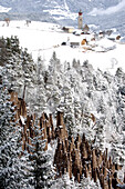 Earth pyramids and mountain village in winter, Lengmoos, Mittelberg, South Tyrol, Alto Adige, Italy, Europe