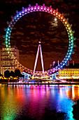 Big Wheel aka London Eye lit up with the rainbow colours during Pride night, London, UK