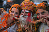 Cloured Dye On Female Tourists Who Pose With Rajasthani Guy With Long Beard At Elephant Festival, Jaipur, Rajasthan State, India. Asia