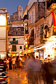 People In Alleys At Dusk With Santa Maria Cathedral On Hill Behind, Ibiza Town, Ibiza, Spain