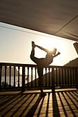 Lady doing yoga at Ibiza Yoga, Benirras, Ibiza, Spain.