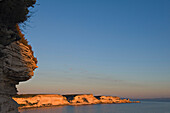 Limestone sea cliffs near Bonifacio. At sunset, Corse du Sud. Corsica. France
