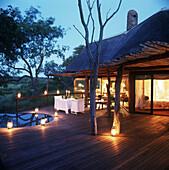 Romantic patio with lanterns, Luxury safari lodge, Singita Boulders, South Africa