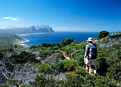 Walker going along path in the Cape of Good Hope Nature Reserve, Western Cape, South Africa