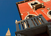 Detail of Venetian house with church spire in the background, Piran, Slovenia.