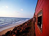 Train traveling to Columbo at dusk, Sri Lanka