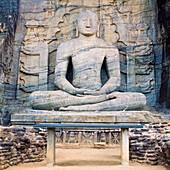 A giant stone carved seated Buddha, Gal Vihara, Polonnaruwa (Polonnaruva), UNESCO World Heritage Site, Sri Lanka, Asia.