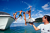 young people in swim suits diving, St. Barts, French West Indies