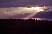 Sun breaking through overcast sky, Abisko, Sweden