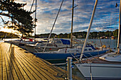 Boats lining up along the pier in marina, Uto Island, Stockholm, Sweden.