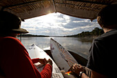 Travelling surfers on river in Tanzania, Tanzania, East Africa
