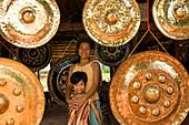 Woman embracing girl, Ban Sai Mun, Isan, Thailand
