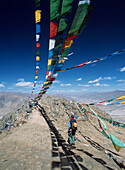 Woman walking along ridge, Tibet