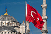 Turkish flag in front of the Sultanahmet or Blue Mosque, Istanbul, Turkey.