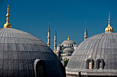 Looking across the domed rooves of the Haghia Sophia to the Sultanahmet or Blue Mosque, Istanbul, Turkey.