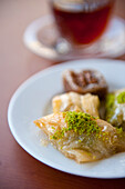 Plate of Baklava and cup of Turkish tea, Istanbul, Turkey.