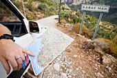 Tourist in car checking map, Close Up, Mugla, Turkey.
