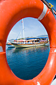 View of moored boats through the life ring from another boat, Fethiye Bay, Turkey
