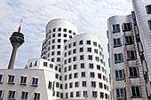 The Rheinturm and Frank Gehry's Neuer Zollhof, Medienhafen, Düsseldorf, Germany, Europe