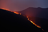 Italy, Sicily, red lava flow in the Valle del Bove at night