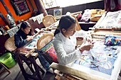 China, Yunnan province, Lijiang, Bueyi people embroideresses