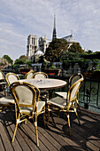 France, Paris, restaurant terrace on a barge, Notre Dame cathedral in background