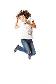 Girl jumping, listening to MP3 player