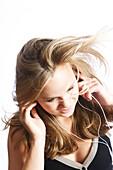 Teenage girl listening to MP3 player