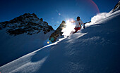 France, Alps, Savoie, Courchevel 1850, female skier in action