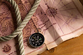 Marine map, compass and rope