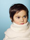 Portrait of little girl looking away