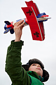 Boy playing with model airplane