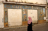 Algeria, Algiers, woman in the street, closed café