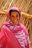 Algeria, region of Tamanrasset, Ahaggar desert, portrait of smiling tuareg woman