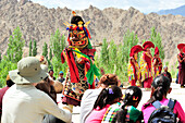 Tourists watching mask dance, monastery festival, Phyang, Leh, valley of Indus, Ladakh, Jammu and Kashmir, India