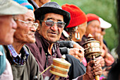 Men with prayer wheels, monastery festival, Phyang, Leh, valley of Indus, Ladakh, Jammu and Kashmir, India