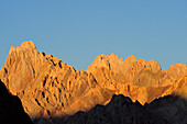 Evening light at jagged rocky summit, Zanskar Range Traverse, Zanskar Range, Zanskar, Ladakh, India